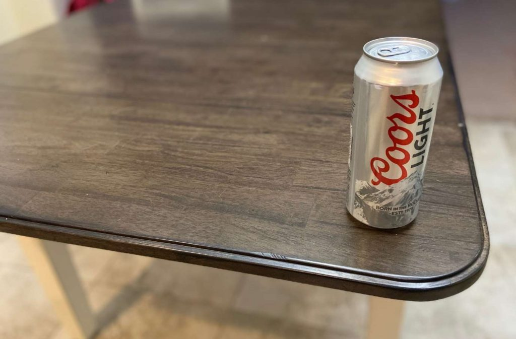 Beer can on table for Four Corners drinking game.