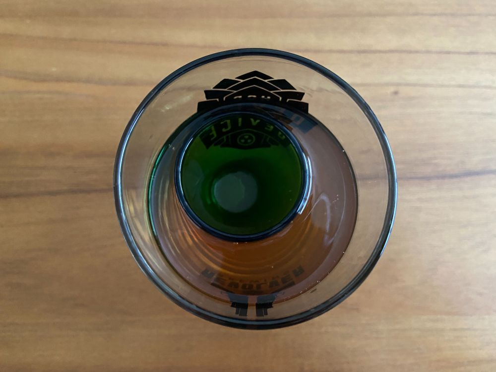 Shot glass floating in beer glass for the drinking game titanic.